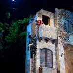 Romeo (Dante Rossi) climbs to Juliet's (adison Hart) balcony
